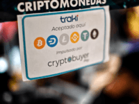 View of a sign advertising the payment with Venezuelan cryptocurrency Petro at a store in Caracas, on December 28, 2019. - The government of Venezuelan President Nicolas Maduro granted an end-of-year bonus to retirees and public employees equivalent to half a Petro (some 30 US dollars), five times more than …