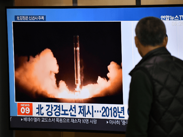 A man watches a television news programme showing file footage of North Korea's missile test, at a railway station in Seoul on January 1, 2020. - North Korean leader Kim Jong Un has declared an end to its moratoriums on nuclear and intercontinental ballistic missile tests and threatened a demonstration …