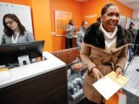 Lieutenant Governor of Illinois Juliana Stratton smiles after making a purchase at Sunnyside Cannabis Dispensary on January 1, 2020 in Chicago, Illinois. - On the first day of 2020, recreational marijuana became legal in Illinois, which joins 10 other US states with legal use of recreational marijuana. (Photo by KAMIL …