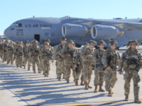 This handout picture released by the US Army shows U.S. Army Paratroopers assigned to the 2nd Battalion, 504th Parachute Infantry Regiment, 1st Brigade Combat Team, 82nd Airborne Division, deploy from Pope Army Airfield, North Carolina on January 1, 2020. - Paratroopers from 2nd Battalion, 504th Parachute Infantry Regiment, 1st Brigade …