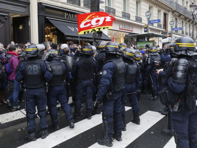 Riot police surround striking employees of Paris' RATP public transport operator during their action against French government's pensions overhaul, on January 2, 2020 in Paris. (Photo by FRANCOIS GUILLOT / AFP) (Photo by FRANCOIS GUILLOT/AFP via Getty Images)
