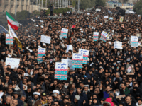 "Iranians hold anti-US banners during a demonstration in the capital Tehran on January 3, 2020 following the killing of Iranian Revolutionary Guards Major General Qasem Soleimani in a US strike on his convoy at Baghdad international airport. - Iran warned of ""severe revenge"" and said arch-enemy the United States bore …"