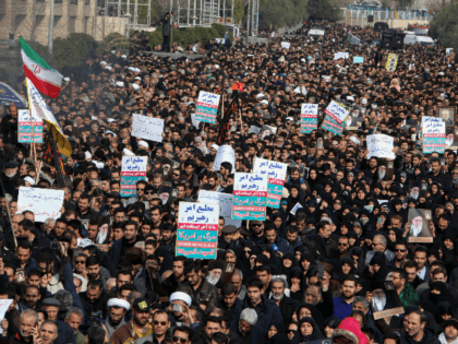 """Iranians hold anti-US banners during a demonstration in the capital Tehran on January 3, 2020 following the killing of Iranian Revolutionary Guards Major General Qasem Soleimani in a US strike on his convoy at Baghdad international airport. - Iran warned of """"severe revenge"""" and said arch-enemy the United States bore …"""