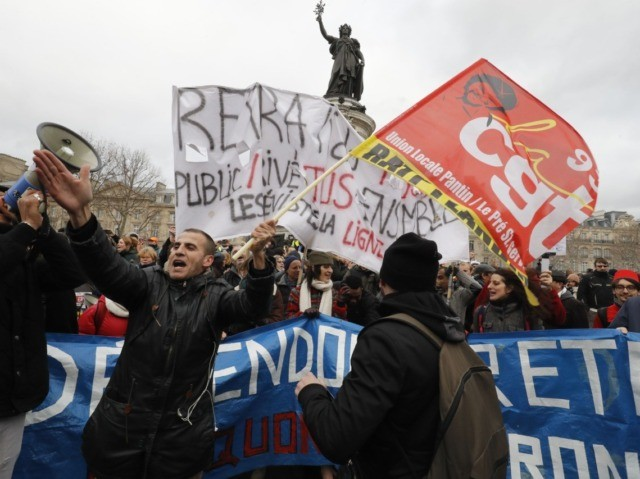 Protestors hold banners during a demonstration called by French national trade union General Confederation of Labour (CGT) against the pension reform on January 4, 2020, on the Place de la Republique in Paris. - After 30 days of strike, unions opposed to the pension reform promise not to give respite …