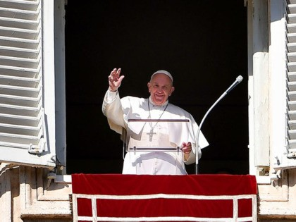 Pope Francis waves to worshipers from the window of the Apostolic palace overlooking St. Peter's Square during the Angelus prayer on January 6, 2020 in the Vatican. (Photo by Vincenzo PINTO / AFP) (Photo by VINCENZO PINTO/AFP via Getty Images)