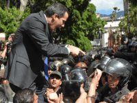 Venezuelan opposition leader and self-proclaimed acting president Juan Guaido confronts Bolivarian National Guard members upon arrival at the National Assembly, in Caracas, on January 7, 2020. - Opposition leader Juan Guaido and a rival lawmaker, Luis Parra -who both had claimed to be Venezuela's parliament speaker, following two separate votes …