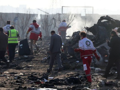 Rescue teams work amidst debris after a Ukrainian plane carrying 176 passengers crashed near Imam Khomeini airport in the Iranian capital Tehran early in the morning on January 8, 2020, killing everyone on board. - The Boeing 737 had left Tehran's international airport bound for Kiev, semi-official news agency ISNA …