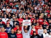 "TOPSHOT - Supporters of US President Donald Trump attend a ""Keep America Great"" campaign rally at Huntington Center in Toledo, Ohio, on January 9, 2020. (Photo by SAUL LOEB / AFP) (Photo by SAUL LOEB/AFP via Getty Images)"