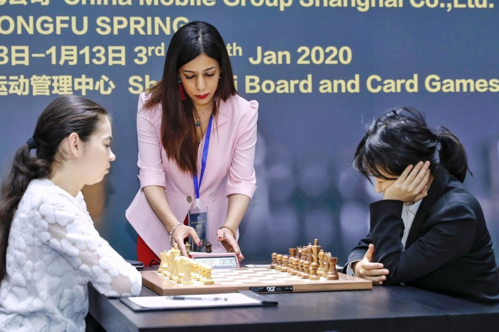 Shohreh Bayat (C), chief arbiter for the match between Aleksandra Goryachkina (front L) of Russia and Ju Wenjun (front R) of China, prepares for the match during the 2020 International Chess Federation (FIDE) Women's World Chess Championship in Shanghai on January 11, 2020. (STR/AFP via Getty)
