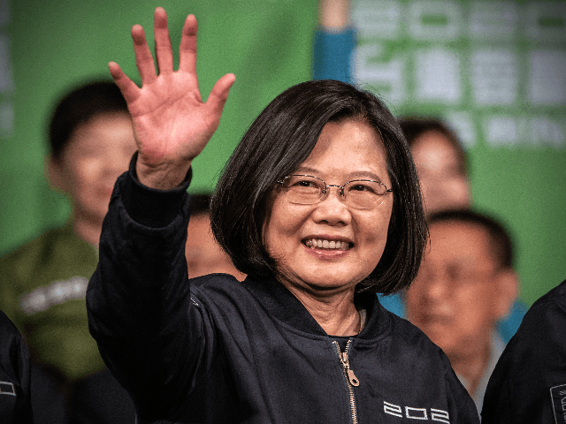 TAIPEI, TAIWAN - JANUARY 11: Tsai Ing-Wen waves after addressing supporters following her re-election as President of Taiwan on January 11, 2020 in Taipei, Taiwan. Tsai Ing-Wen of the Democratic Progressive Party (DPP) has been re-elected as Taiwans president as voters displayed their disapproval of Beijing by opting for a …