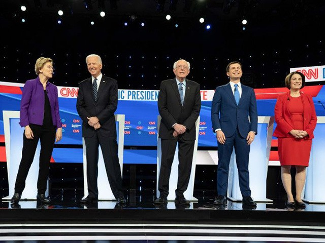 (L-R) Democratic presidential hopefuls billionaire-philanthropist Tom Steyer, Massachusetts Senator Elizabeth Warren, Former Vice President Joe Biden, Vermont Senator Bernie Sanders, Mayor of South Bend, Indiana, Pete Buttigieg and Minnesota Senator Amy Klobuchar stand on stage ahead of the seventh Democratic primary debate of the 2020 presidential campaign season co-hosted by …