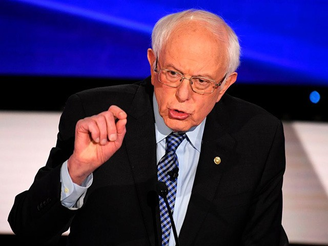 (L-R) Democratic presidential hopeful Vermont Senator Bernie Sanders speaks during the seventh Democratic primary debate of the 2020 presidential campaign season co-hosted by CNN and the Des Moines Register at the Drake University campus in Des Moines, Iowa on January 14, 2020. (Photo by Robyn Beck / AFP) (Photo by …