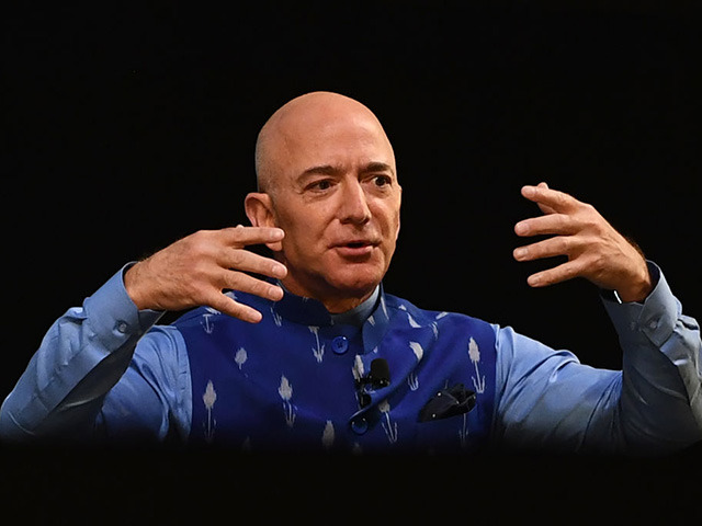 CEO of Amazon Jeff Bezos (R) gestures as he addresses the Amazon's annual Smbhav event in New Delhi on January 15, 2020. - Bezos, whose worth has been estimated at more than $110 billion, is officially in India for a meeting of business leaders in New Delhi. (Photo by Sajjad …