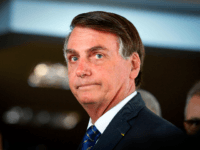 Brazilian President Jair Bolsonaro arrives for a press conference on electricity and gasoline at the Ministry of Mines and Energy in Brasilia, on January 15, 2020. - Bolsonaro spoke about Brazil's possible entry to the Organisation for Economic Co-operation and Development (OECD). (Photo by Sergio LIMA / AFP) (Photo by …