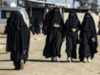 Women walk inside the Kurdish-run al-Hol camp for the displaced in the al-Hasakeh governorate in northeastern Syria on January 14, 2020, at the section reserved for Iraqis and Syrians. - Particularly difficult living conditions in the camp reportedly resulted in the death of more than 517 people, including 371 children …