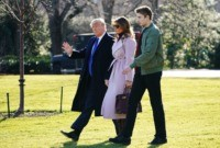 US President Donald Trump, First Lady Melania Trump and son Barron Trump make their way to board Marine One from the South Lawn of the White House in Washington, DC on January 17, 2020. - Trump is traveling to Palm Beach, Florida. (Photo by MANDEL NGAN / AFP) (Photo by …