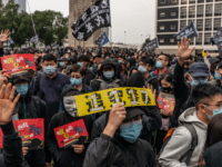 Protesters take part in a Universal Siege On Communists' rally at The Cenotaph in Central district on January 19, 2020 in Hong Kong, China. Anti-government protesters in Hong Kong rally ahead of Lunar New Year to continue their demands for an independent inquiry into police brutality, the retraction of the …