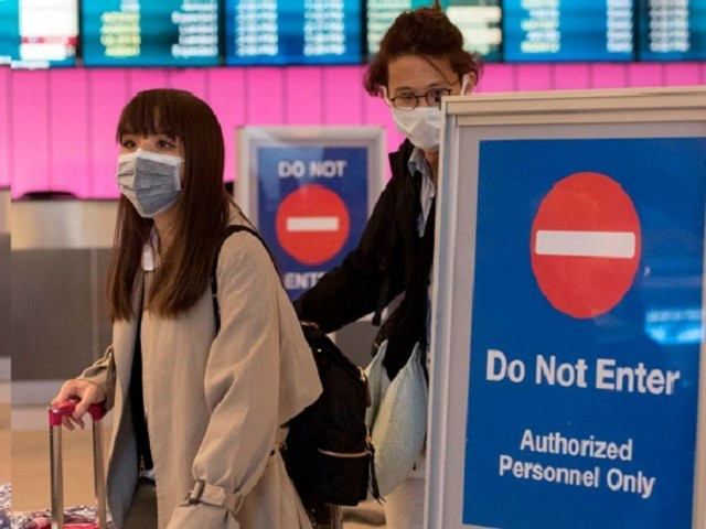 Passengers wear protective masks to protect against the spread of the Coronavirus as they arrive at the Los Angeles International Airport, California, on January 22, 2020. - A new virus that has killed nine people, infected hundreds and has already reached the US could mutate and spread, China warned on …