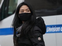 A woman wears a protective mask near the Chinatown section of New York City on January 23, 2020,as many people were seen wearing the mask in the area since the outbreak of the Wuhan Coronavirus. - Authorities in Texas are investigating a second suspected case on US soil of a …