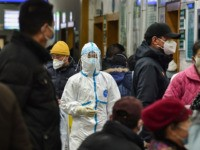 TOPSHOT - A medical staff member (C) wearing protective clothing to help stop the spread of a deadly virus which began in the city, walks at the Wuhan Red Cross Hospital in Wuhan on January 24, 2020. - Chinese authorities rapidly expanded a mammoth quarantine effort aimed at containing a …