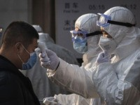 First Europe Coronavirus Cases as Beijing Locks Down 56 Million People