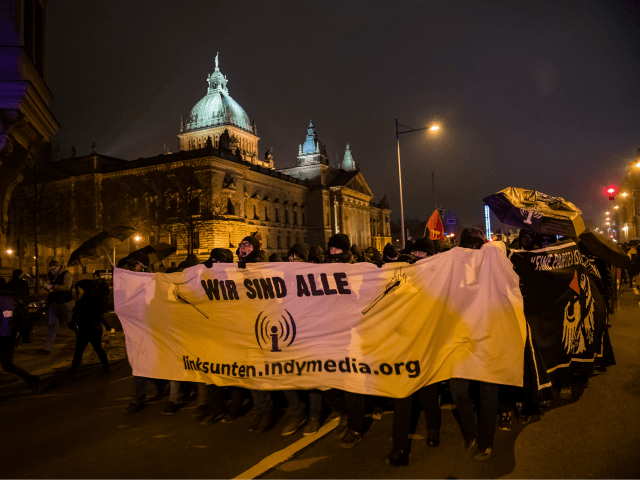 Demonstrators protest against the ban of the Indymedia left-wing extremist online platform, on January 25, 2020 in front of the Federal Administrative Court in Leipzig, eastern Germany. (Photo by STRINGER / AFP) (Photo by STRINGER/AFP via Getty Images)