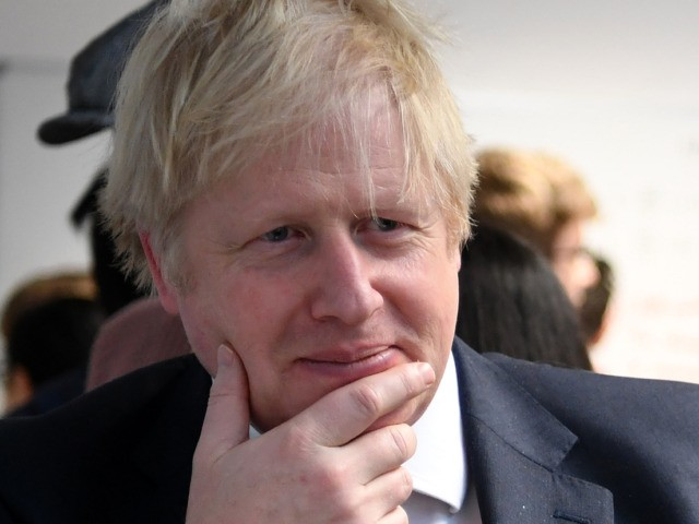 """LONDON, ENGLAND - JANUARY 27: Prime Minister Boris Johnson reacts as he listens to students during his visit to the Department of Mathematics at King's Maths School, part of King's College London University on January 27, 2020 in London, England. The government announced the launch of a new """"global talent …"""