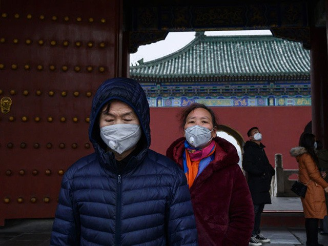 BEIJING, CHINA - JANUARY 27: Chinese visitors wear protective masks as they tour the Temple of Heaven, which remained open during the Chinese New Year and Spring Festival holiday on January 27, 2020 in Beijing, China. The number of cases of a deadly new coronavirus rose to over 2700 in …