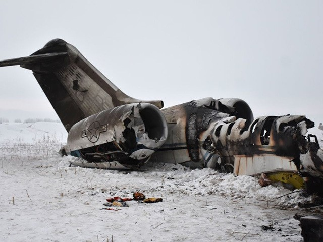 TOPSHOT - In this photograph taken on January 27, 2020 the wreckage of a US Bombardier E-11A jet is seen after it crashed in mountainous territory of Deh Yak district in Ghazni Province. - A US military jet crashed in mountainous territory in eastern Afghanistan, where there is a heavy …