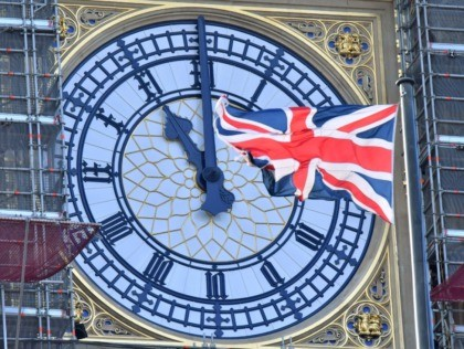 The clock face of Elizabeth Tower, known after the bell Big Ben, shows the hands at eleven o'clock as a Union Flag flies in front of it in London on January 28, 2020. - Britain will formally leave the European Union at 11pm GMT on January 31, 2020. (Photo by …