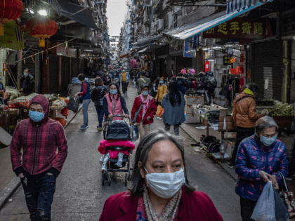 Residents wearing face masks shop at a market on January 28, 2020 in Macau, China. The number of cases of a deadly new coronavirus rose to over 4000 in mainland China Tuesday as health officials locked down the city of Wuhan last week in an effort to contain the spread …