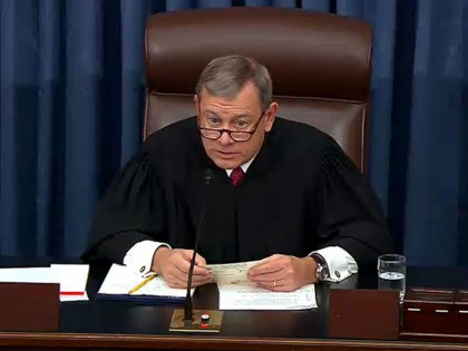 WASHINGTON, DC - JANUARY 29: In this screengrab taken from a Senate Television webcast, Chief Justice John Roberts reads a question from a senator during impeachment proceedings against U.S. President Donald Trump in the Senate at the U.S. Capitol on January 29, 2020 in Washington, DC. Senators have 16 hours …