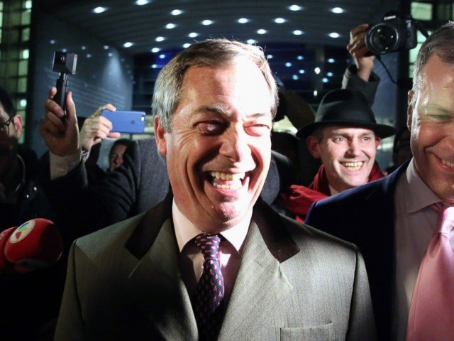 Britain's Brexit Party leader Nigel Farage (C) leaves the European Parliament after a plenary session to vote on the Brexit deal in Brussels on January 29, 2020. - The European Parliament on January 29 voted overwhelmingly to approve the Brexit deal with London, clearing the final hurdle for Britain's departure …