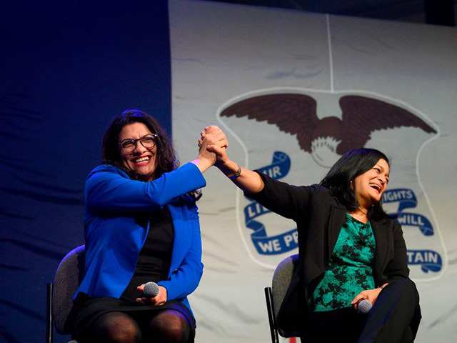 US Congresswoman Rashida Tlaib (L), D-MI, high-fives US Congresswoman Pramila Jayapal (C), D-WA, with US Congresswoman Ilhan Omar, D-MN, as they speak to supporters of Democratic presidential candidate Senator Bernie Sanders at a campaign event in Clive, Iowa, on January 31, 2020. (Photo by JIM WATSON / AFP) (Photo by …