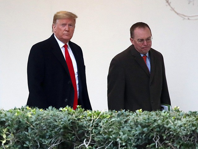 WASHINGTON, DC - JANUARY 13: U.S. President Donald Trump walks along the West Wing Colonnade with acting White House chief of staff, Mick Mulvaney (R) before departing from the White House on January 13, 2020 in Washington, DC. President Trump is traveling to Kenner, LA to attend the college football national …