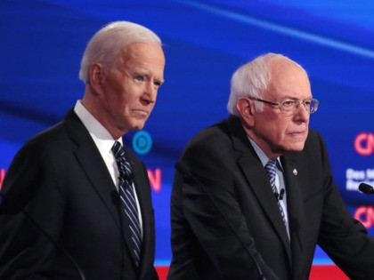 DES MOINES, IOWA - JANUARY 14: Former Vice President Joe Biden (L), Sen. Bernie Sanders (I-VT) and former South Bend, Indiana Mayor Pete Buttigieg (R) participate in the Democratic presidential primary debate at Drake University on January 14, 2020 in Des Moines, Iowa. Six candidates out of the field qualified …