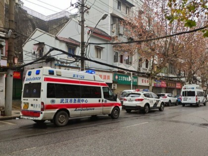 "WUHAN, CHINA - JANUARY 22: An ambulance and police respond to a sick person on January 22, 2020 in Wuhan, China. The cause of the person's illness is as of yet unknown. A new infectious coronavirus known as ""2019-nCoV"" was discovered in Wuhan as the number of cases rose to …"