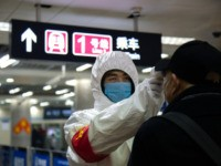 BEIJING, CHINA - JANUARY 26: A health worker checks the temperature of a man entering the subway on January 26, 2020 in Beijing, China. The number of cases of coronavirus rose to 1,975 in mainland China on Sunday. Authorities tightened restrictions on travel and tourism this weekend after putting Wuhan, …