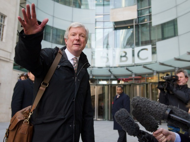 Tony Hall gestures as he arrives for his first day as Director General of the BBC at New Broadcasting House in central London on April 2, 2013. Having previously worked as Chief Executive at the Royal Opera House, the new BBC chief must now deal with the fallout from allegations …