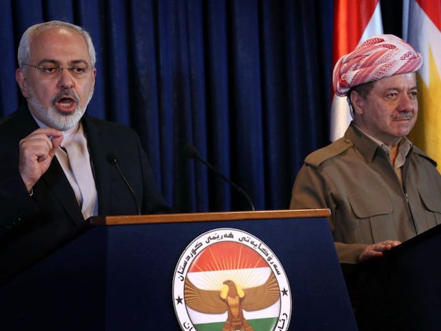 Iranian Foreign Minister Mohammad Javad Zarif (L) and Iraqi Kurdish leader Massud Barzani give a joint press conference following their meeting in Arbil, the capital of the Kurdish autonomous region of northern Iraq on August 26, 2014 . Zarif is on a two-day visit to Iraq, as it fights a …