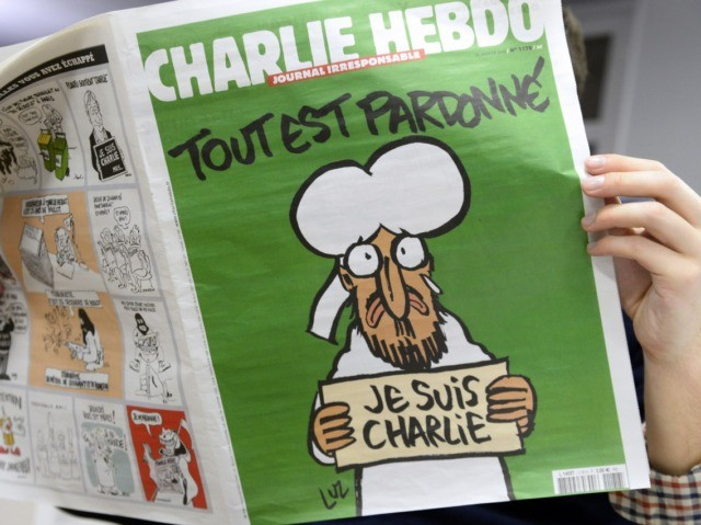 "A man reads, in a newsroom in Paris, the last issue of French satirical weekly Charlie Hebdo on January 13, 2015. A defiant Charlie Hebdo cover of a crying Prophet Mohammed above the slogan ""All is Forgiven"" was reproduced by media around the world on January 13, its first since …"