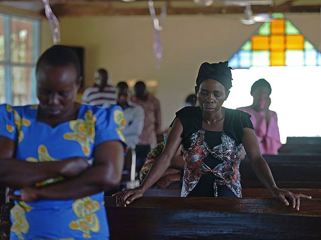 Anglican Church goers in Garissa observe a moment of silence and prayer for those who lost their lives in the terrorist attack on Garissa University, mourning the country's worst ever massacres, on April 5, 2015. Kenyans prayed for unity on April 5 at the start of three days of national …