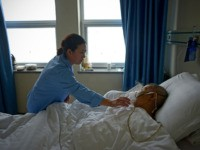 A man suffering from pneumonia receives treatment in a ward at Wang Fu Hospital in Beijing on December 9, 2015. Seeking treatment for respiratory illnesses, Beijing hospital-goers complained on December 9 that their conditions were being worsened by toxic smog, now in its third day and which prompted authorities to …