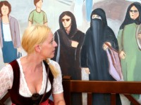 MUNICH, GERMANY - SEPTEMBER 15: A woman sits under a painting inside the Hocker-Pschorr tent that shows a woman in a burka and other Muslim women wearing headscarves in what tent woner Toni Roiderer says is a common a sight in the city center during a press preview at Theresienwiese …