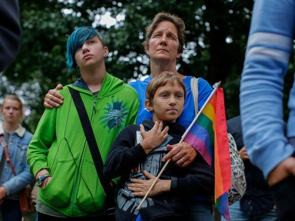 A woman and her two children attend the LGBT Pilgrimage of Mercy in Central Park New York on October 2, 2016.