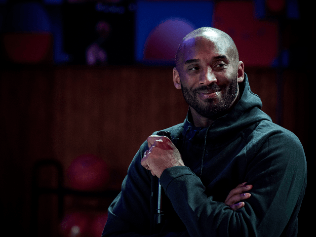 """Former NBA basketball player Kobe Bryant attends a promotional event organized by the sports brand Nike, for the inauguration of the infrastructure improvements of a local basketball playground at the Jean-Jaures sports hall """"Le Quartier"""", in Paris on October 21, 2017. / AFP PHOTO / PHILIPPE LOPEZ (Photo credit should …"""