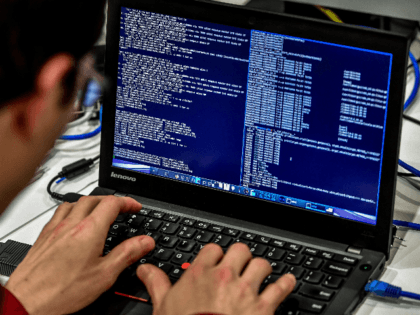 A person works at a computer during the 10th International Cybersecurity Forum in Lille on January 23, 2018. / AFP PHOTO / Philippe Huguen (Photo credit should read PHILIPPE HUGUEN/AFP via Getty Images)
