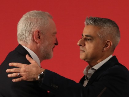 Britain's opposition Labour party leader Jeremy Corbyn (L) and The Mayor of London, Sadiq Khan embrace during the launch of Labours local election campaign in central London on April 9, 2018. / AFP PHOTO / Daniel LEAL-OLIVAS (Photo credit should read DANIEL LEAL-OLIVAS/AFP via Getty Images)