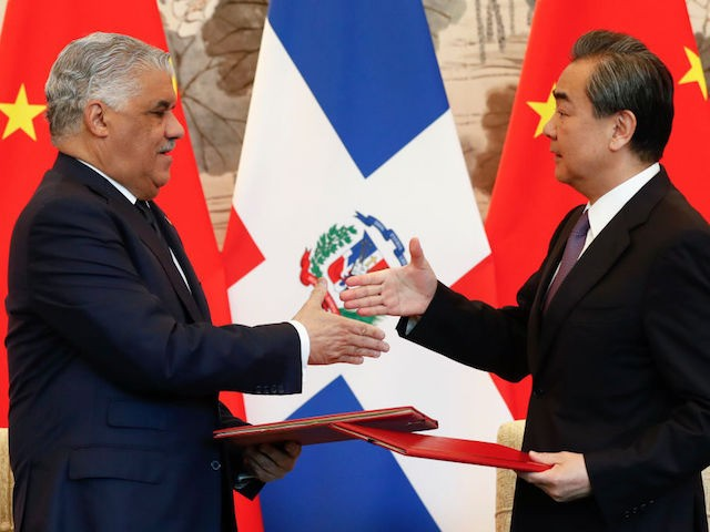 BEIJING, CHINA - MAY 1: China's State Councilor and Foreign Minister Wang Yi shakes hands with Dominican Republic's Chancellor Miguel Vargas during a signing ceremony on May 1, 2018 in Beijing, China. (Photo by Damir Sagolj - Pool/Getty Images)
