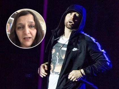 (INSET: Figen Murray) US singer Eminem performs at the Orange Stage during Roskilde Festival 2018, in Roskilde, Denmark, on July 4, 2018. (Photo by Torben Christensen / Ritzau Scanpix / AFP) / Denmark OUT (Photo credit should read TORBEN CHRISTENSEN/AFP via Getty Images)